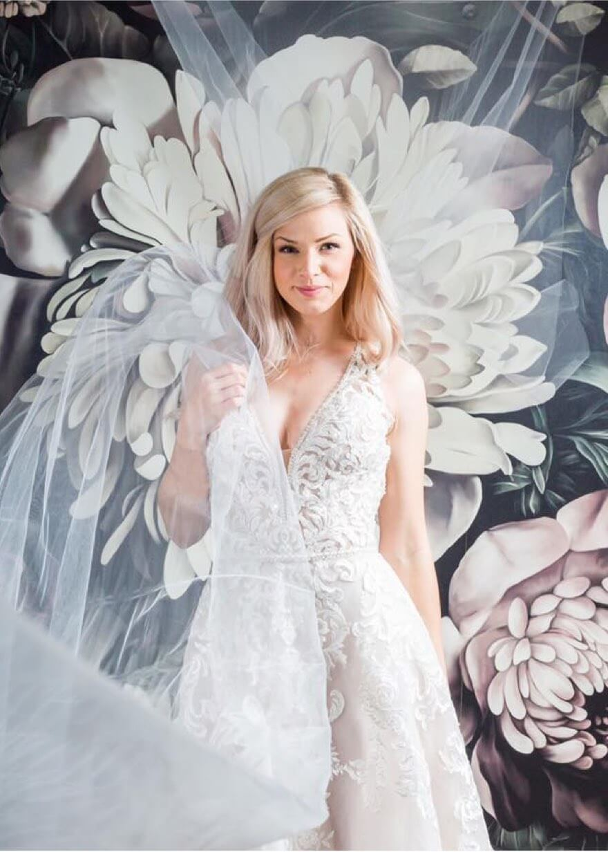 Model wearing a Rina's bridal dress