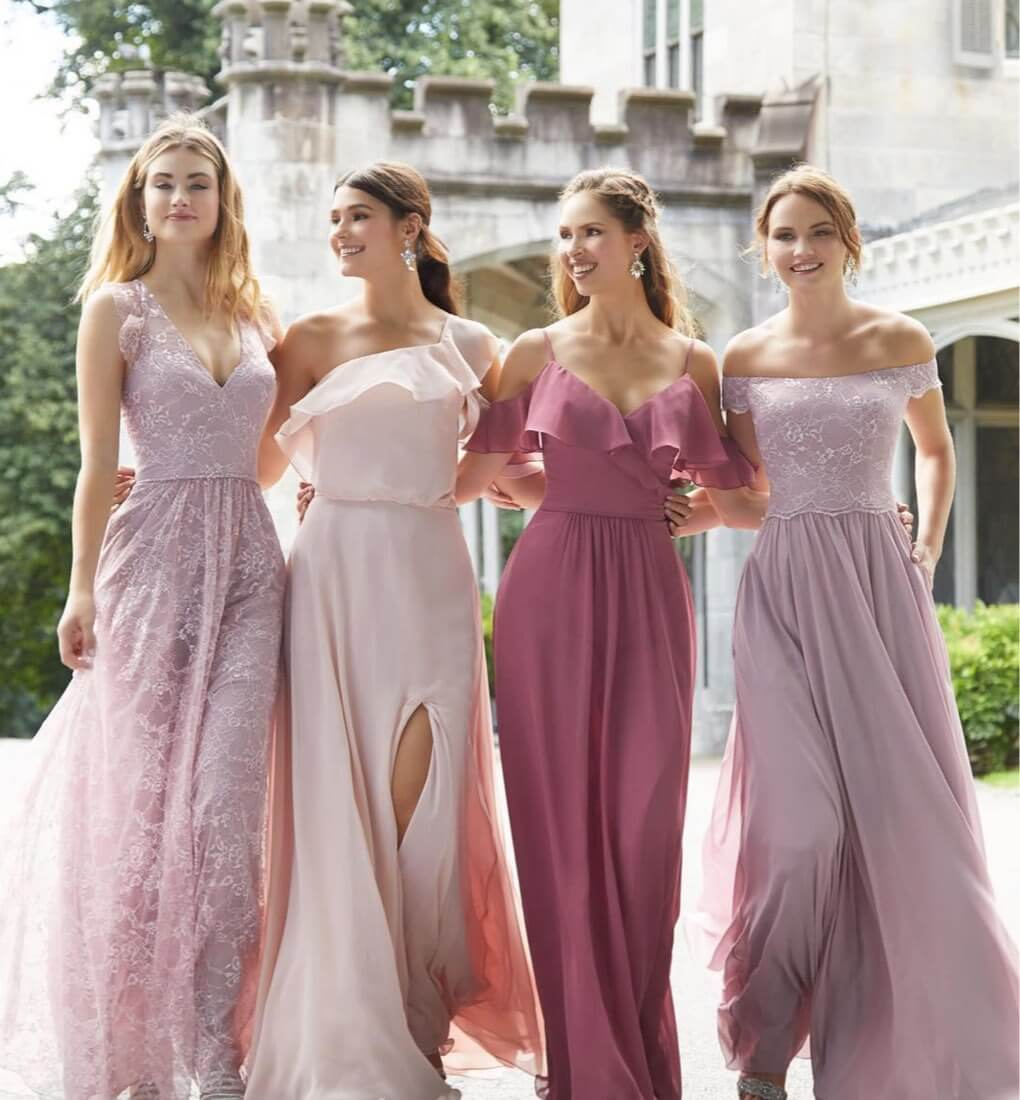 Bridesmaids wearing long pink dresses